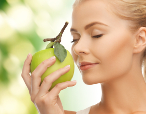 http://www.dreamstime.com/royalty-free-stock-images-woman-smelling-apple-image38289999