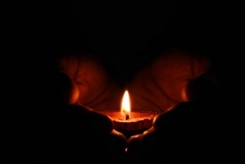 lit candle for quad accident