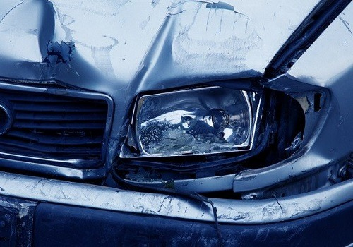 blue car with damaged front end in head-on crash